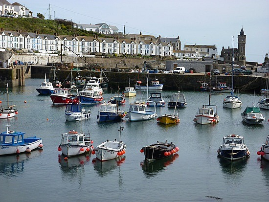 Boats in the harbour at Porthleven, venue for our stained glass holiday workshop