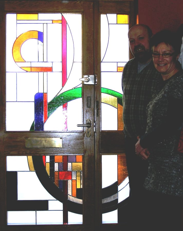 Deb and Mick with the completed windows, installed by Mick
