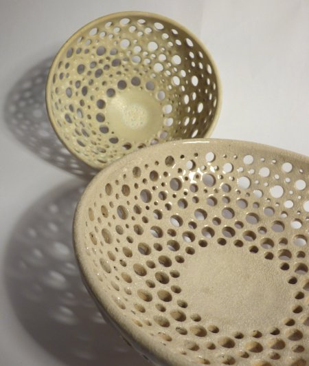 Small and medium raku fired ventilated bowls by Adam Hoytle