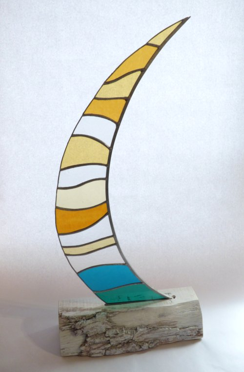 Boomer - freestanding sail shaped stained glass on a wooden base from Vitreus Art