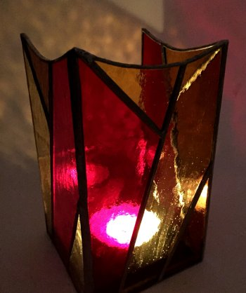 A colourful stained glass candleholder made on the Vitreus Art workshop