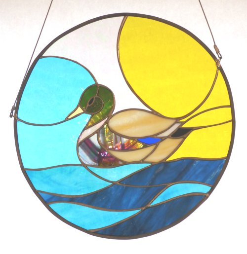 Stained glass by Jenny Timms of Vitreus Art - Irises in a round design