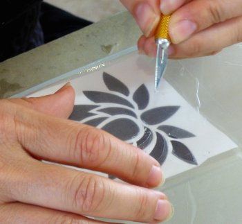 Create areas of glass frosting by cutting out areas of etch resist