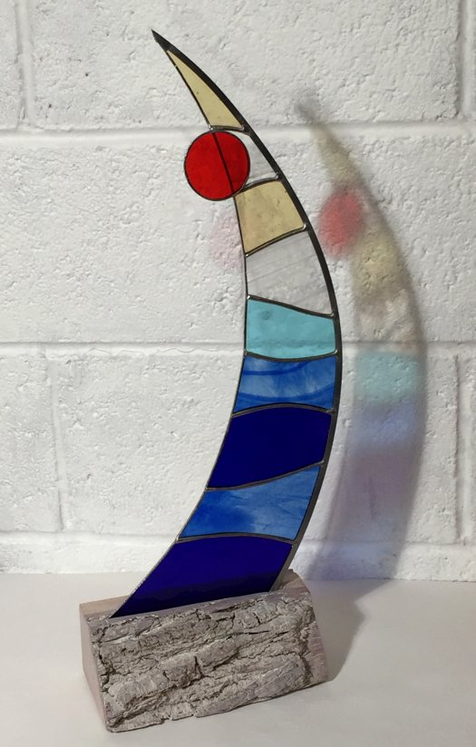 Latitude - freestanding sail shaped stained glass on a wooden base from Vitreus Art