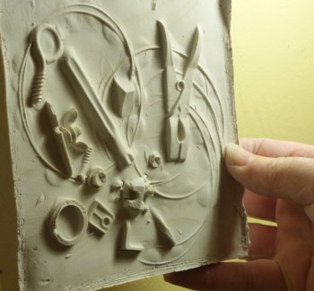 Bring natural or man made materials to use in your plaster cast relief tile artwork