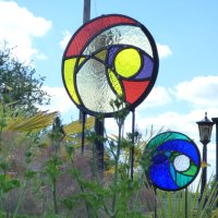 Round glass and metal garden panels - Click to view