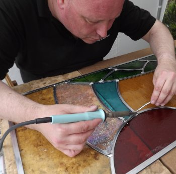 Mike Caddy soldering stained glass